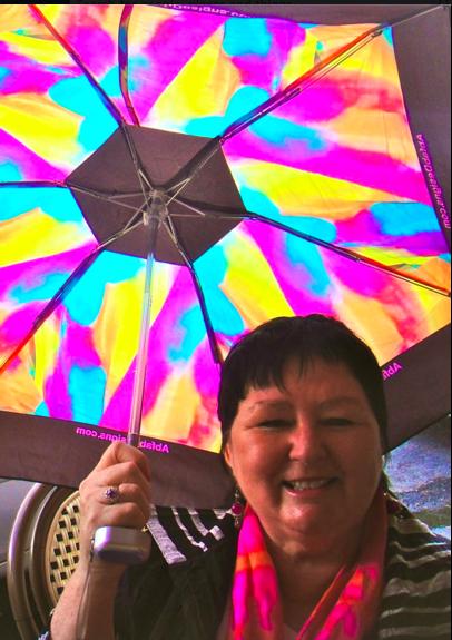 Teena in Place des Vosges, Paris, with the Provence design mini folding umbrella